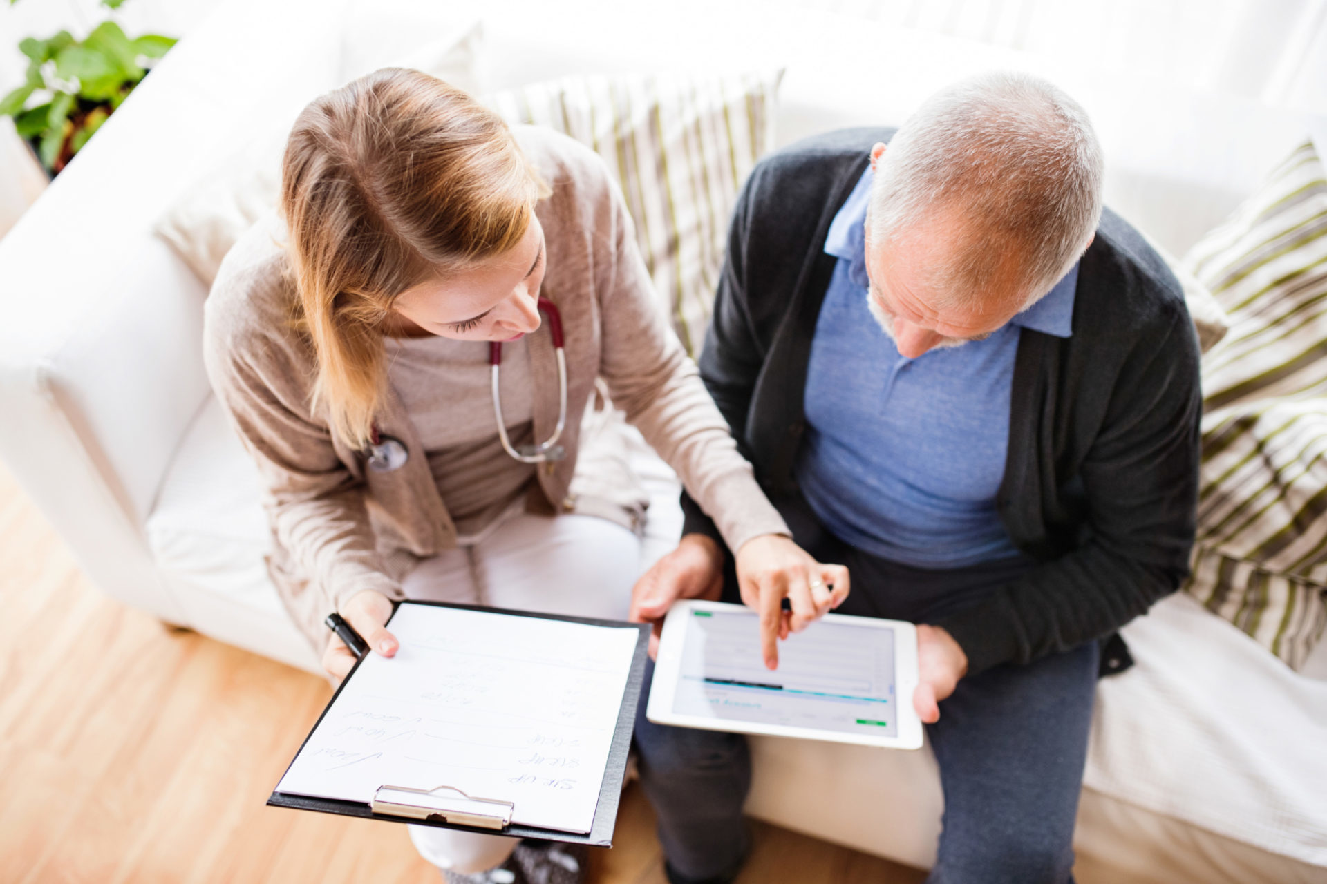 woman doctor consulting with older male patient